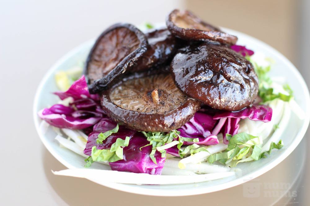 jacques pepin\'s braised shiitake mushrooms on bitter greens